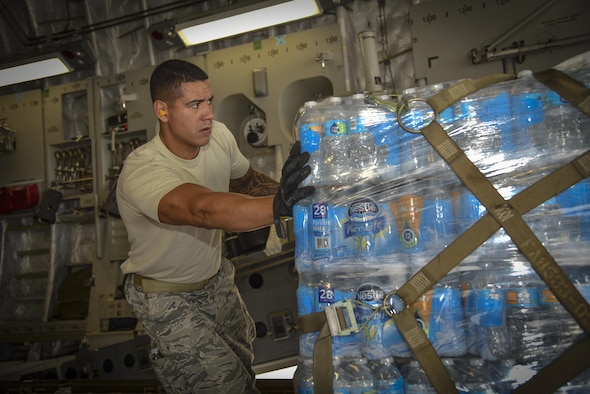 U.S. Air Force Senior Airman Allan Canizales assigned to the 6th Logistics Readiness Squadron, prepares a pallet of water to be offloaded at MacDill Air Force Base, Fla., Sept. 12, 2017.