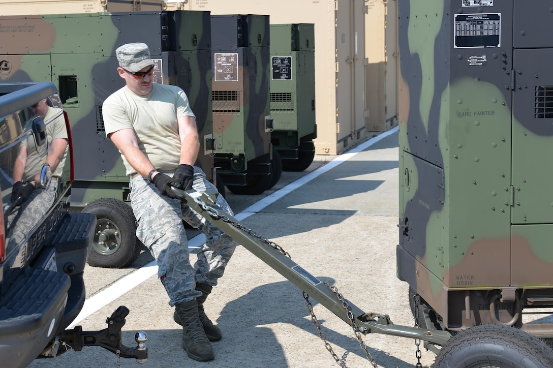 Tech Sgt. Daniel Mooers, Power Production Technician, 260th Air Traffic Control Squadron, readies a MEP 806 Power Generator for deployment to the Virgin Islands as part of the Hurricane Irma Relief effort.  The generators are part of the Disaster Relief Bed Down Kit (DRBS) stored here at Pease Air National Guard Base.  (N.H. Air National Guard Photo By Master Sgt. Thomas Johnson)