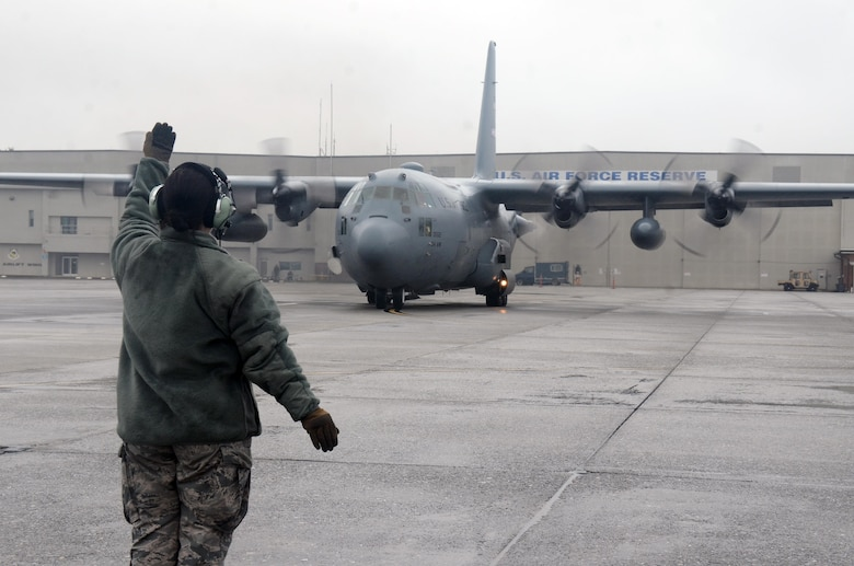 An Airman guides a C-130H3 Hercules as it taxis on the runway at Dobbins Air Reserve Base, Ga. Sept. 12, 2017. Reserve Citizen Airmen of the 700th Airlift Squadron delivered supplies and personnel to Homestead Air Reserve Base, Florida, to assist relief and reconstitution operations at the installation and in the local South Florida community. (U.S. Air Force photo/Don Peek)