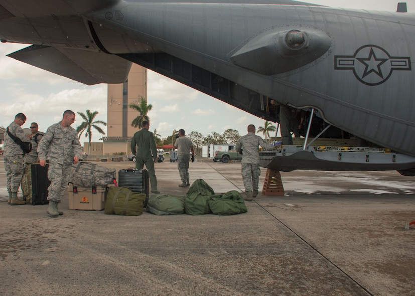Passengers retrieve their luggage on the flightline at Homestead Air Reserve Base, Fla. Sept. 12, 2017. These passengers included civil engineer and public affairs personnel to assist with hurricane relief operations. (U.S. Air Force photo/Staff Sgt. Andrew Park)