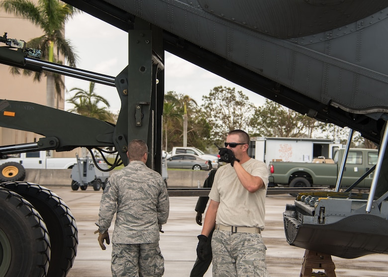 An Airman talks on the radio as a forklift begins offloading cargo from a C-130H3 Hercules at Homestead Air Reserve Base, Fla. Sept. 12, 2017. 94th Airlift Wing C-130s and aircrews provided airlift support Sept. 12, 2017 as part of the Air Force Reserve's relief efforts following Hurricane Irma. (U.S. Air Force photo/Staff Sgt. Andrew Park)