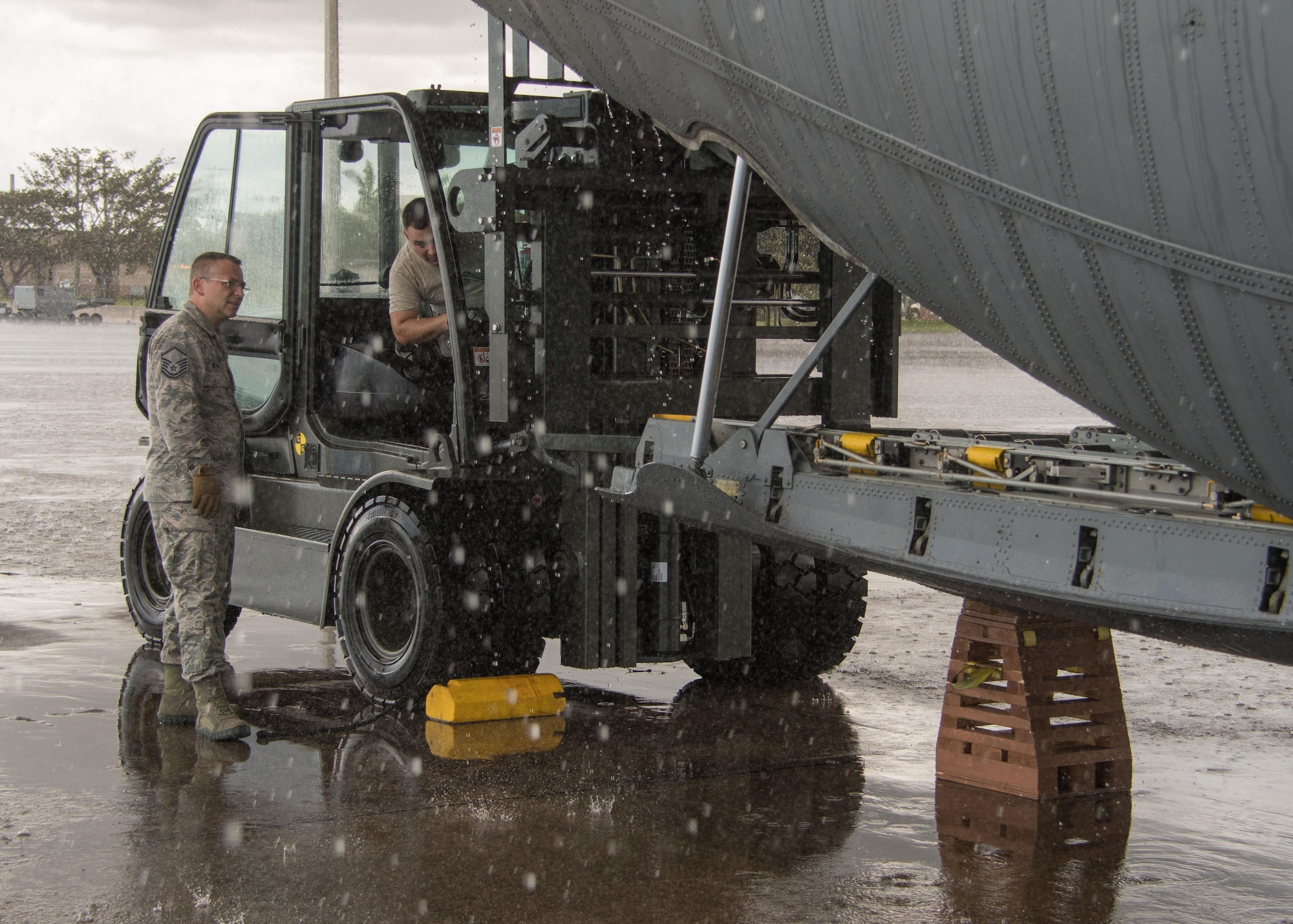 Aerial porters offloads cargo from a C-130H3 Hercules at Homestead Air Reserve Base, Fla. Sept. 12, 2017. 94th Airlift Wing C-130s and aircrews provided airlift support as part of the Air Force Reserve's relief efforts following Hurricane Irma. (U.S. Air Force photo/Staff Sgt. Andrew Park)