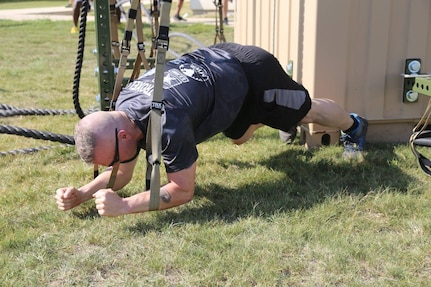 CSM Troxell demonstrates his own planking style while participating in the PT with the rest of the Soldiers.