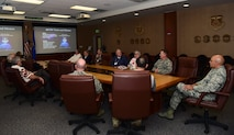 The 460th Space Wing leadership and members of the Tan Son Nhut Association discuss the history of the wing Sept. 14, 2017, in the 460th SW Headquarters building on Buckley Air Force Base, Colo.