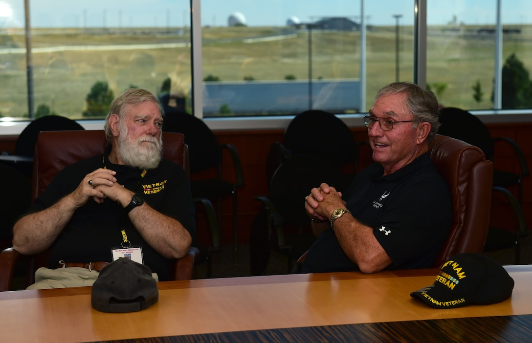 Jim Faulkner, Tan Son Nhut Association member, and Richard Carvell, Tan Son Nhut Association vice president, speak during a history briefing Sept. 14, 2017, in the 460th Headquarters building on Buckley Air Force Base, Colo.