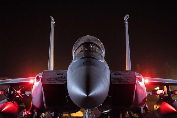 An airman performs preflight checks on an F-15E assigned to the 332nd Air Expeditionary Wing in Southwest Asia, Sept. 9, 2017. The wing is supporting efforts to defeat the Islamic State of Iraq and Syria. Air Force photo by Senior Airman Damon Kasberg