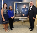 Retired Gen. Mark A. Welsh III, former chief of staff of the Air Force, and Betty Welsh pose with artist Michele Rushworth before the portrait unveiling ceremony in the Pentagon, Washington, D.C., Sept. 14, 2017. The portrait will be on display in the Pentagon's Arnold Corridor alongside the portraits of all the other former Air Force chiefs of staff. (U.S. Air Force photo by Wayne A. Clark)