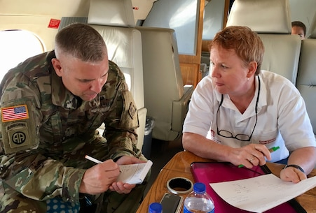 Wilmington District Commander Col. Robert Clark and the District's Chief of Emergency Operations, Janelle Mavis, discuss recovery efforts while en route to the U.S. Virgin Islands. (USACE photo by Angela Zephier)