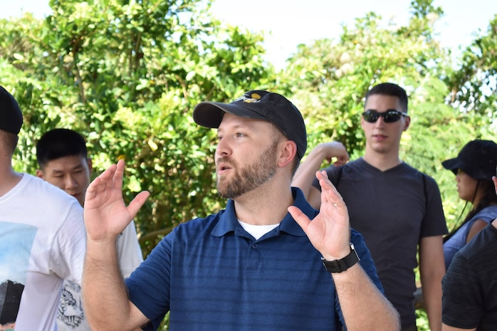 Brett Manis, 18th Wing chief historian, speaks to Airmen about the historical significance of visiting Hacksaw Ridge Aug. 25, 2017, at Urasoe, Japan. Airmen from Kadena Air Base visited Hacksaw Ridge to learn more about military history during the Battle of Okinawa in World War II. (Courtesy photo)