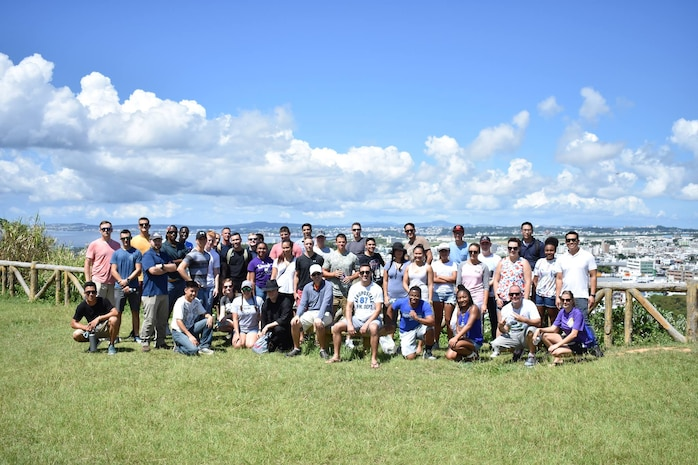 U.S. Airmen pose for a photo atop Hacksaw Ridge Aug. 25, 2017, at Urasoe, Japan. Airmen from Kadena Air Base visited Hacksaw Ridge with the 18th Wing History Office and 18 Wing Chapel to learn about how spiritual resiliency helped save lives during the battle. (Courtesy photo)