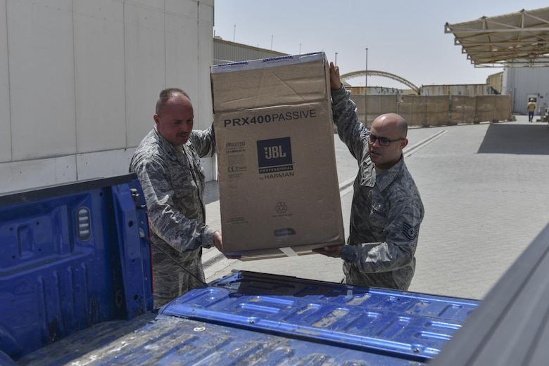 Chaplain (Capt.) James Longe, left, and chaplain's assistant Tech. Sgt. Siddartha Sosa-Rodriguez load a box of donated goods into a truck at Al Dhafra Air Base, United Arab Emirates, Sept. 8, 2017.