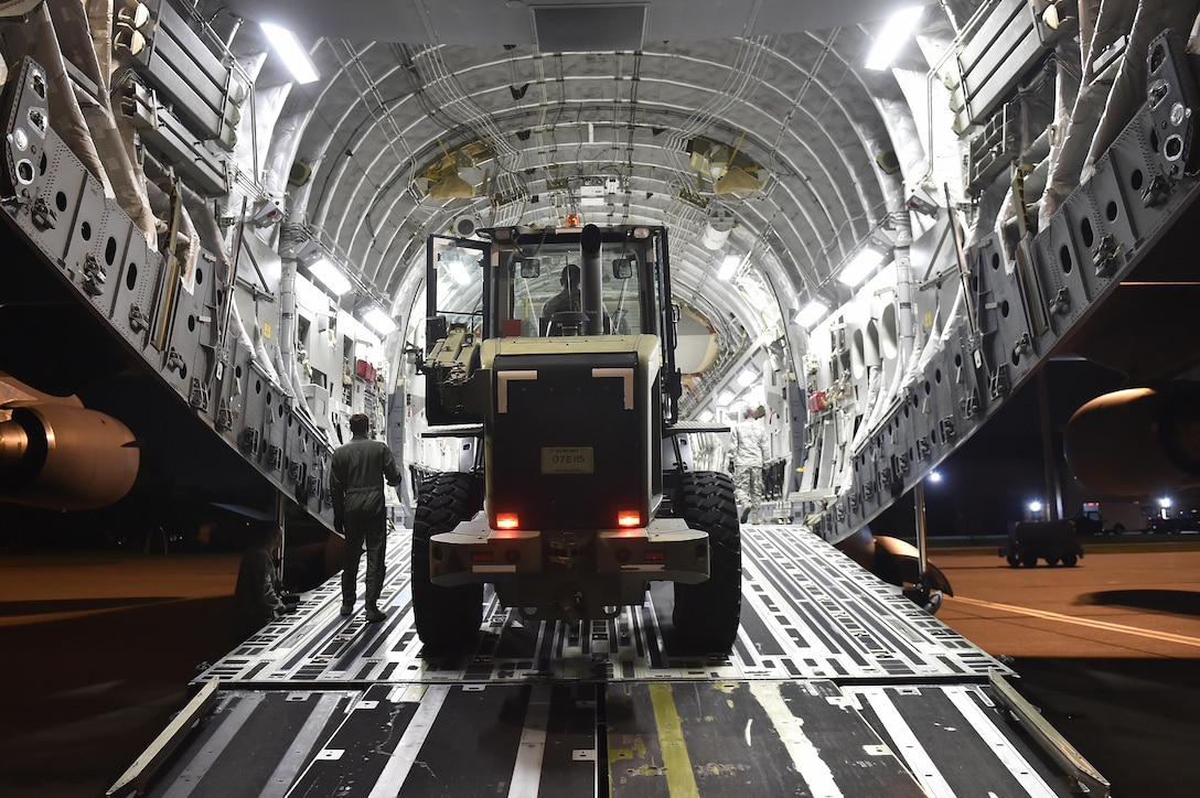 A loadmaster from the 16th Airlift Squadron signals a 10K All Terrain forklift onto a C-17 Globemaster III aircraft, Sep. 13, 2017, at Scott Air Force Base, Ill.   A 17-member contingency response team from the 821st Contingency Response Group from Travis Air Force Base, Calif., deployed to Homestead Air Reserve Base, Fla., to augment the 439th Airlift Wing airfield capabilities in support of Hurricane Irma relief efforts.  (U.S. Air Force photo by Tech. Sgt. Liliana Moreno/Released)