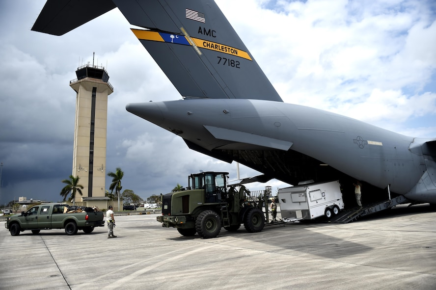 Contingency Response Airmen offload cargo from a C-17 Globemaster III, Sep. 13, 2017, at Homestead Air Reserve Base, Fla.  A 17-member contingency response team from the 821st Contingency Response Group from Travis Air Force Base, Calif., deployed to Homestead ARB to augment the 439th Airlift Wing airfield capabilities in support of Hurricane Irma relief efforts.  (U.S. Air Force photo by Tech. Sgt. Liliana Moreno/Released)