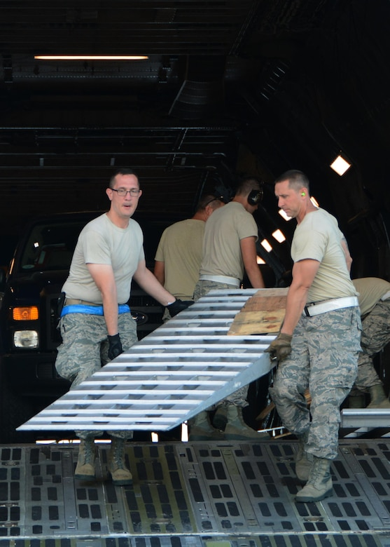 Westover aerial porters, from both the 42nd and 58th squadrons, help unload supplies and equpiment that will aid in Hurricane Irma relief efforts.