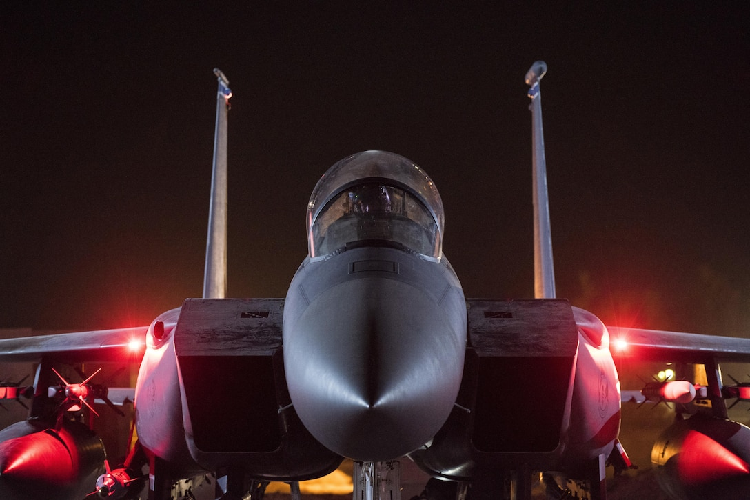 Aircrew perform preflight checks on an F-15E Strike Eagle assigned to the 332nd Air Expeditionary Wing, Sep. 9, 2017, in Southwest Asia. The 332nd AEW continuously flies missions throughout the region to combat the threat of the Islamic State of Iraq and Syria. (U.S. Air Force photo by Senior Airman Damon Kasberg)