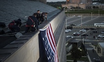 A large American flag is unfurled over the west side of the Pentagon at sunrise in Arlington, Va., Sept. 11, 2017. During the Sept. 11, 2001 attacks, 184 people were killed at the Pentagon. (DoD photo by Tech. Sgt. Brigitte N. Brantley)