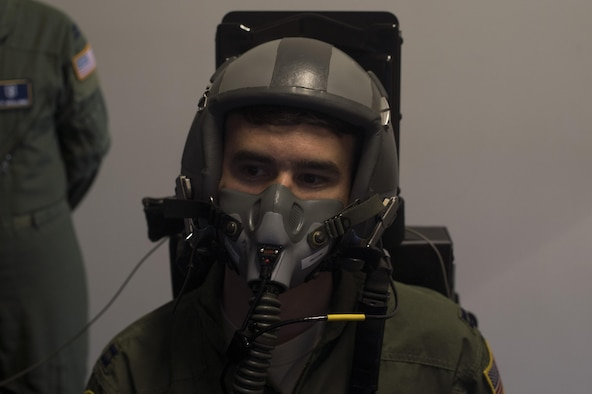 A U.S. Air Force 86th Operations Support Squadron pilot flies a simulated aircraft while hooked up to the 86th Aerospace Medicine Squadron Aerospace Physiology's reduced oxygen breathing device on Ramstein Air Base, Germany, Sept. 13, 2017. Aerospace physiology Airmen use the ROBD to familiarize pilots and other crew members with the effects of hypoxia, the lack of oxygen at high altitudes, and how to mitigate the symptoms and safely complete their mission. (U.S. Air Force photo by Senior Airman Tryphena Mayhugh)