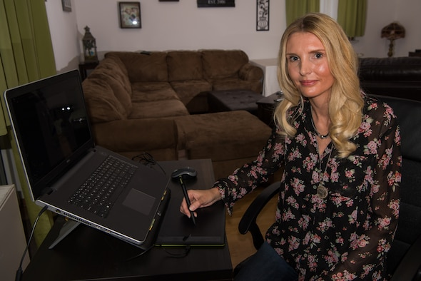 Sabine Allen, graphic designer and spouse of U.S. Army Staff Sgt. Anthony Allen, Religious Service Office noncommissioned officer in charge at Kleber Kaserne, uses her drawing tablet at her home on Vogelweh Military Complex, Germany, Sept. 13, 2017. Allen recently won the 86th Force Support Squadron Continuous Process Improvement office and Innovation Program's logo contest. (U.S. Air Force photo by Airman 1st Class Devin M. Rumbaugh)