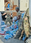 Soldiers of 3rd Battalion, 133rd Field Artillery Regiment based in El Paso, Texas with first responders, the Cajun Navy and civilian volunteers tirelessly work points of distribution as relief teams to provide Texans affected by Hurricane Harvey more than 18,000 cases of water daily and nearly 320,000 pounds of ice, and tens of thousands of pounds of donated necessities, such as toilet paper, baby food and diapers, tarps, hygiene items, clothing and cleaning supplies, Sept. 3 2017.