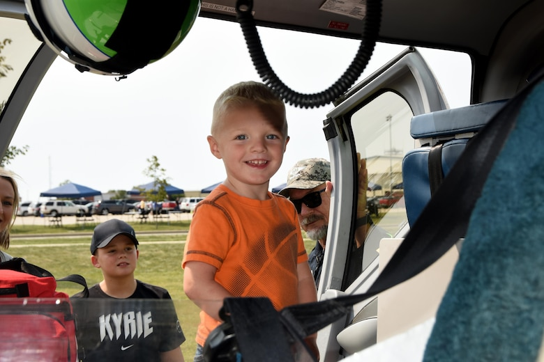 Max, son of Tech. Sgt. Samantha Matheney, 178th Wing Contracting Office gets a tour of a Careflight helicopter during the wing's Family Day event Sept. 10, 2017.