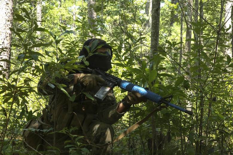 A Marine covertly approaches an opposing force to initiate an ambush during defensive operations training at Camp Lejeune, N.C., Aug. 30, 2017. The exercise is used by the battalion to improve proficiency with combat tactics and in preparation for future operations. The Marine is with Echo Company, 2nd Battalion, 8th Marine Regiment. (U.S. Marine Corps photo by Lance Cpl. Holly Pernell)