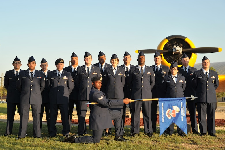 Airman Leadership School Class 17-F stands before the T-6 Texan static plane display on Goodfellow Air Force Base, Texas, Aug. 31, 2017. ALS is a six-week course designed to prepare senior airmen to assume supervisory duties, offering instruction in leadership and followership, written and oral communication skills, and the profession of arms. (U.S. Air Force photo by Airman 1st Class Randall Moose/Released)