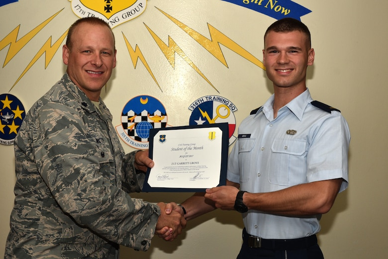 U.S. Air Force Lt. Col. Steven Watts, 17th Training Group Deputy commander, presents the 315th Training Squadron Officer Student of the Month award for August 2017 to 2nd Lt. Garrett Grove, 315th Training Squadron student, at Brandenburg Hall on Goodfellow Air Force Base, Texas, Sept. 8, 2017. (U.S. Air Force photo by Senior Airman Scott Jackson/Released)