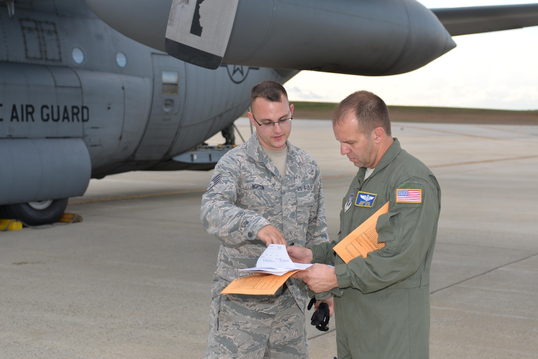 TSgt Andrew Norton, air transportation specialist, 157th Logistic Readiness Squadron, and Master Sgt. Mickey Dixon, Load Master, 142nd Air Lift Squadron, New Castle, Delaware discuss payload information prior to loading a Disaster Relief Bed Down Kit (DRBS) onto a C-130 Hercules Aircraft for deployment to the Virgin Islands in response to the Irma relief effort at Pease Air National Guard Base.  (N.H. Air National Guard Photo by Master Sgt. Thomas Johnson)