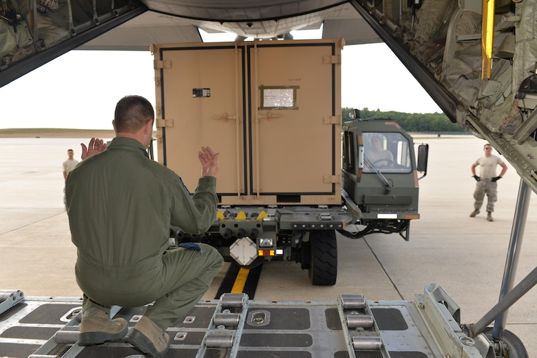 SrA Alyssa Rosenberg, ramp services representative, 157th Air Refueling Wing, operates a K loader as Master Sgt. Micky Dixon, Load Master, 142nd Air Lift Squadron, New Castle, Delaware, guides equipment from the Disaster Relief Bed Down Kit (DRBS) onto a C-130 Hercules aircraft for deployment to the Virgin Islands as part of the Irma Relief effort. The DRBS kit is one of two kits stored here at Pease Air National Guard Base.  (N.H. Air National Guard Photo by Master Sgt. Thomas Johnson)