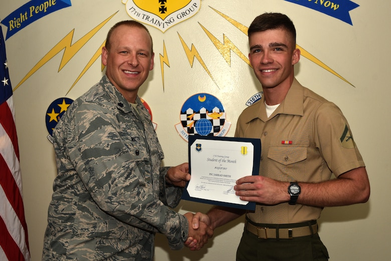 U.S. Air Force Lt. Col. Steven Watts, 17th Training Group Deputy commander, presents the 316th Training Squadron Student of the Month award for August 2017 to U.S. Marine Corps Lance Cpl. Jarrad Smith, 316th Training Squadron student, at Brandenburg Hall on Goodfellow Air Force Base, Texas, Sept. 8, 2017. (U.S. Air Force photo by Senior Airman Scott Jackson/Released)
