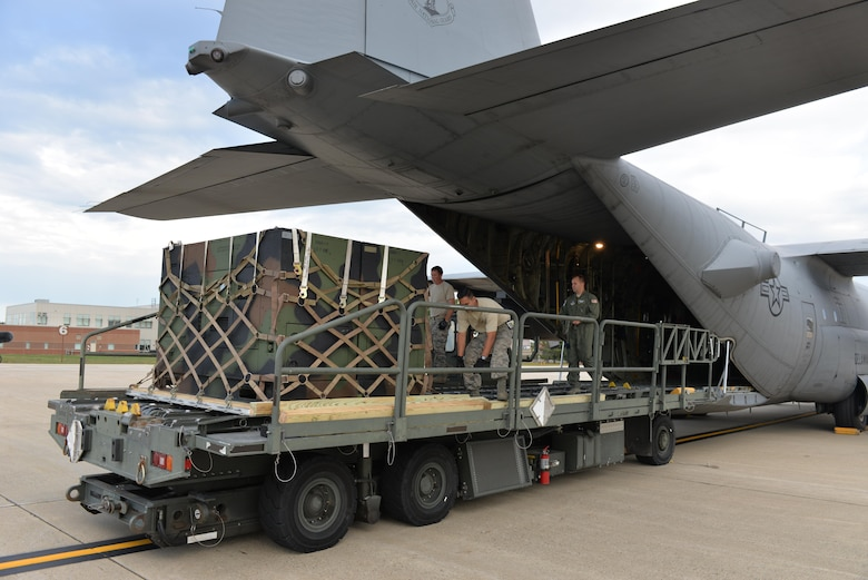 Air National Guard Airman from the 142nd Air Lift Squadron, New Castle, Delaware, guide equipment from the Disaster Relief Bed Down Kit (DRBS) onto a C-130 Hercules aircraft for deployment to the Virgin Islands as part of the Irma Relief effort. The DRBS kit is one of two kits stored here at Pease Air National Guard Base.  (N.H. Air National Guard Photo by Master Sgt. Thomas Johnson)