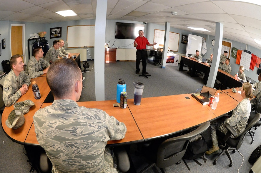 Kelvin Tifft, 526th Electronics Maintenance Squadron, briefs his Airman Leadership School classmates Aug. 21, 2017, at Hill Air Force Base, Utah.