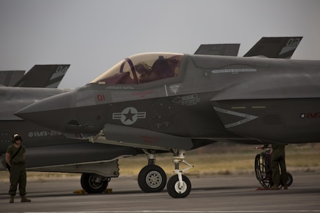 "A pilot with Marine Fighter Attack Squadron (VMFA) 211 ""Wake Island Avengers,"" 3rd Marine Aircraft Wing, conducts the preflight inspection of an F-35B Lightning II on the first day of Red Flag 17-3 at Nellis Air Force Base, Nev., July 10. Red Flag 17-3 is a realistic combat training exercise involving the U.S. Air Force, Army, Navy and Marine Corps and this iteration is the first to have both the Air Force's F-35A Lightning II and the Marine Corps' F-35B Lightning II, which is capable of short takeoff vertical landing (STOVL). (U.S. Marine Corps photo by Sgt. Lillian Stephens/Released)"