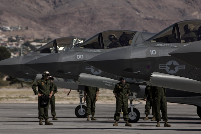 """A pilot with Marine Fighter Attack Squadron (VMFA) 211 """"Wake Island Avengers,"""" 3rd Marine Aircraft Wing, signals to a ground crew member after landing at Nellis Air Force Base, Nev., July 5. A total of 10 F-35B Lightning IIs and 250 Marines with VMFA-211 participated in Red Flag 17-3, a realistic combat training exercise hosted by the U.S. Air Force, to assess the squadron's ability to deploy and support contingency operations using the F-35B. (U.S. Marine Corps photo by Sgt. Lillian Stephens/Released)"""
