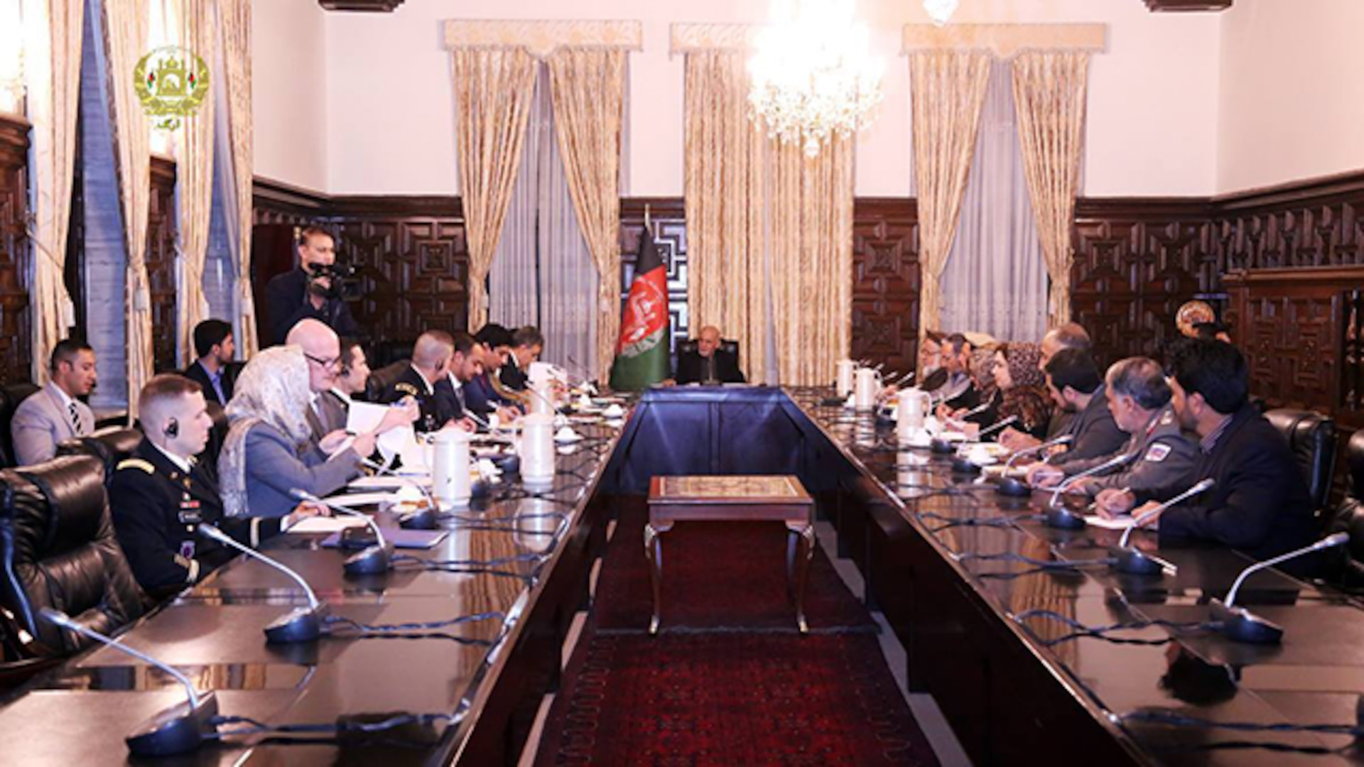 John Griffiths, a Defense Contract Management Agency administrative contracting officer, attends a meeting held by the president of Afghanistan, Ashraf Ghani in Kabul, Afghanistan. Griffiths recently deployed in support of the agency's Contingency Response Force. (Photo courtesy of National Procurement Authority Public Affairs Office)