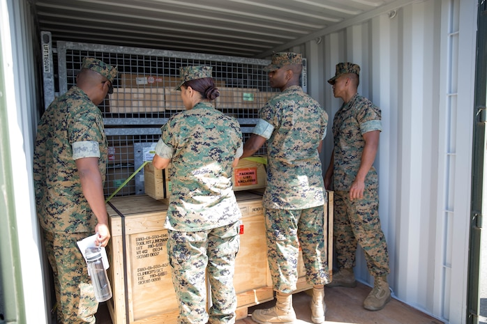 U.S. Marines with several units within the I Marine Expeditionary Force observed a display of how to load and stack a shipping container during Pacific Horizon on Camp Pendleton, Calif., July 12, 2017. Pacific Horizon 2017 is a Maritime Prepositioning Force (MPF) exercise designed to train I Marine Expeditionary Force (I MEF) and components of Naval Beach Group 1 (NBG-1) Marines and Sailors on arrival and assembly operations as well as follow-on Marine Air Ground Task Force actions to ensure that the right equipment, supplies and tools get to the right people to be employed in a crisis response, humanitarian assistance and amassing combat power ashore from sea. (U.S. Marine Corps photo by Lance Cpl. Roxanna Gonzalez)