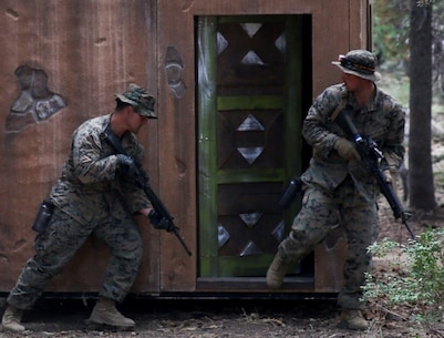 Marines prepare to enter and search a structure for notional improvised explosive devices during a tactical site exploitation drill as part of Mountain Warfare Training in Bridgeport, Calif., Aug. 29, 2017. The first non-infantry iteration of Mountain Warfare Training is a field operation that prepares Marines for mission readiness and aims to build resilience to high altitude atmospheres through real-life training exercises in a mountainous setting.