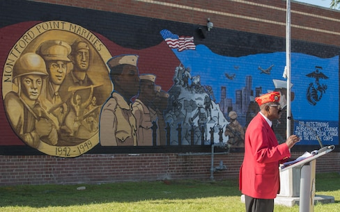 Lamar Harrington, commandant of Montford Point Marine Detachment 158, addresses the crowd at the Mural Unveiling ceremony during Marine Week Detroit, Sept. 9, 2017. Marine Week Detroit is an opportunity to connect with the people of the greater Detroit area, and thank them for their support. (U.S. Marine Corps photo by Lance Cpl. Danny Gonzalez)