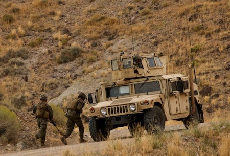 Marines run back to their vehicle after an improvised explosive device detonates during a convoy operation as part of the final exercise of Mountain Warfare Training in Bridgeport, Calif., Sept. 5, 2017. Mountain Warfare Training prepares Marines to fight in high altitude and low temperature environments through a series of training exercises, followed by a final practical application that combines and tests the learned skills.