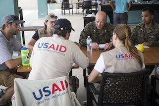 U.S. Marines Col. Michael V. Samarov, center, commander of Joint Task Force - Leeward Islands, and Capt. Ismael Lopez, the civil military operations planner for JTF-LWI, meet with members of the United States Agency for International Development at Saint Martin, Sept. 13, 2017