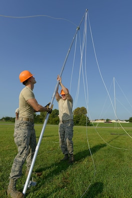 U.S. Air Force Staff Sgt. Nathan Simmons, left, and Staff Sgt. Josiah Schmidt, both Radio Frequency Transmission supervisors assigned to the 509th Communications Squadron (CS), raise an antenna during the Bomber Strategic Aircraft Recovery Team training at Whiteman Air Force Base, Mo., Aug. 30, 2017. The Radio Frequency Transmission Systems Team of the 509th CS performs this training monthly. When activated, they are able to provide full communication to four simultaneous locations around the world.
