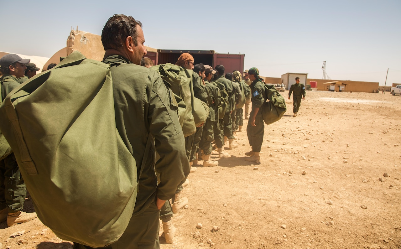 Raqqa Internal Security Force Training Class 005 graduates receive their initial issue of equipment after completing their training in Ayn Issa, Syria.