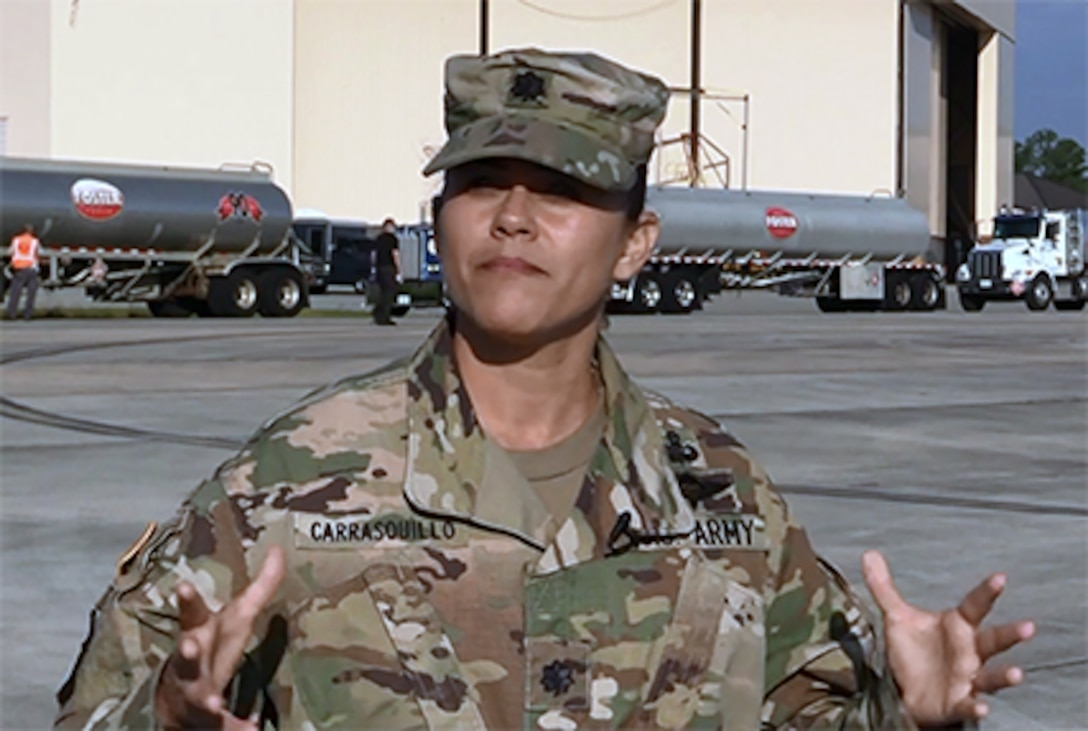 DLA Energy Americas at Houston Commander Army Lt. Col. Josiel Carrasquillo stands in front of Foster Fuels trucks at Warner Robins Air Force Base