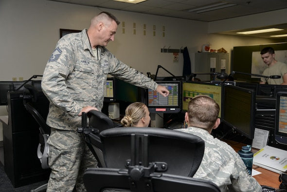 Senior Master Sgt. Jeffrey Hamilton, 436 Airlift Wing Command and Control Operations superintendent, monitors a digital log Sept. 13, 2017, in the Command Post on Dover Air Force Base, Del. C2 Operations Airmen are responsible for notifying commanders and installation personnel of changing safety conditions. (U.S. Air Force photo by Staff Sgt. Aaron J. Jenne)
