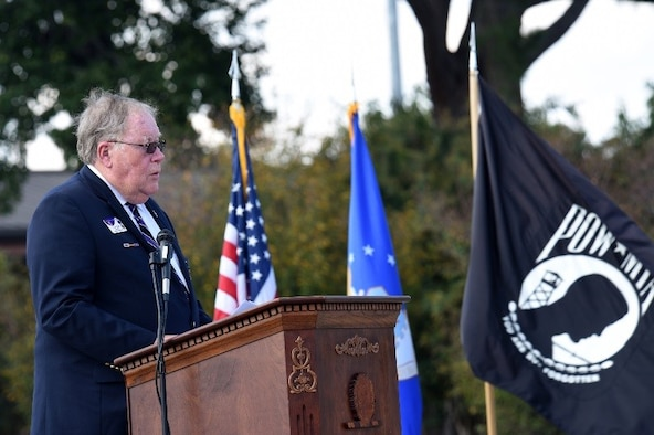 Ret. Capt. Kevin Hynes gives his opening remarks during the Prisoner(s) of War/Missing in Action ceremony, Sept. 14, 2017, at Seymour Johnson Air Force Base, North Carolina. Hynes served as a squadron intelligence officer and navigator in Vietnam, and flew C-123K cargo planes after the war. (U.S. Air Force photo by Airman 1st Class Miranda A. Loera)