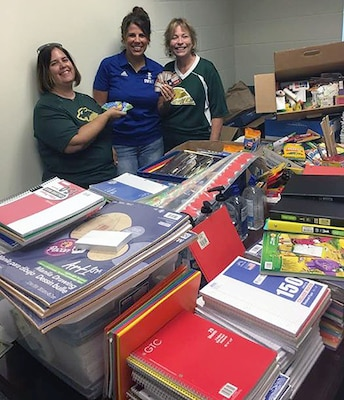 School Supplies 2: Dr. Jill Blankenship, principal of Blaschke Sheldon Elementary in the Ingleside Independent School District; Sylvia Elizondo, the superintendent's administrative assistant; and Lori Fuller, Robert G. Cole's instructional design coach, sort supplies.