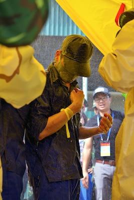 A Vietnamese volunteer undergoes chemical decontamination procedures