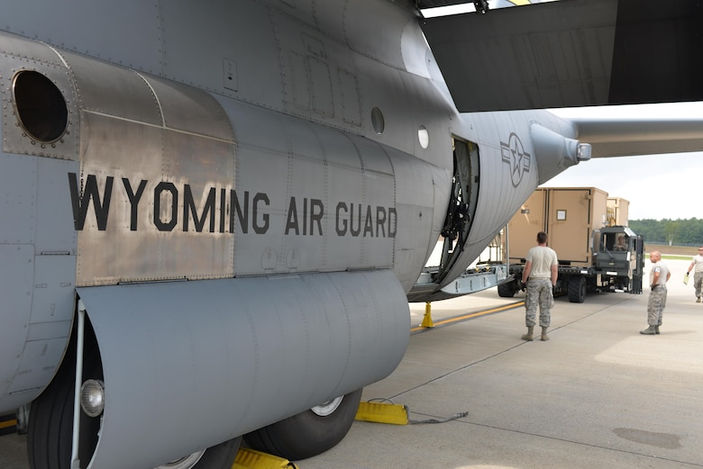 Air National Guardsman from the 157th Air Refueling Wing guide equipment from the Disaster Relief Bed Down Kit (DRBS) onto a C-130 Hercules aircraft from the 187th Airlift Squadron, Cheyenne Air National Guard Base, Wyoming for deployment to the Virgin Islands as part of the Irma Relief effort. The DRBS kit is one of two kits stored here at Pease Air National Guard Base.  (N.H. Air National Guard Photo by Master Sgt. Thomas Johnson)