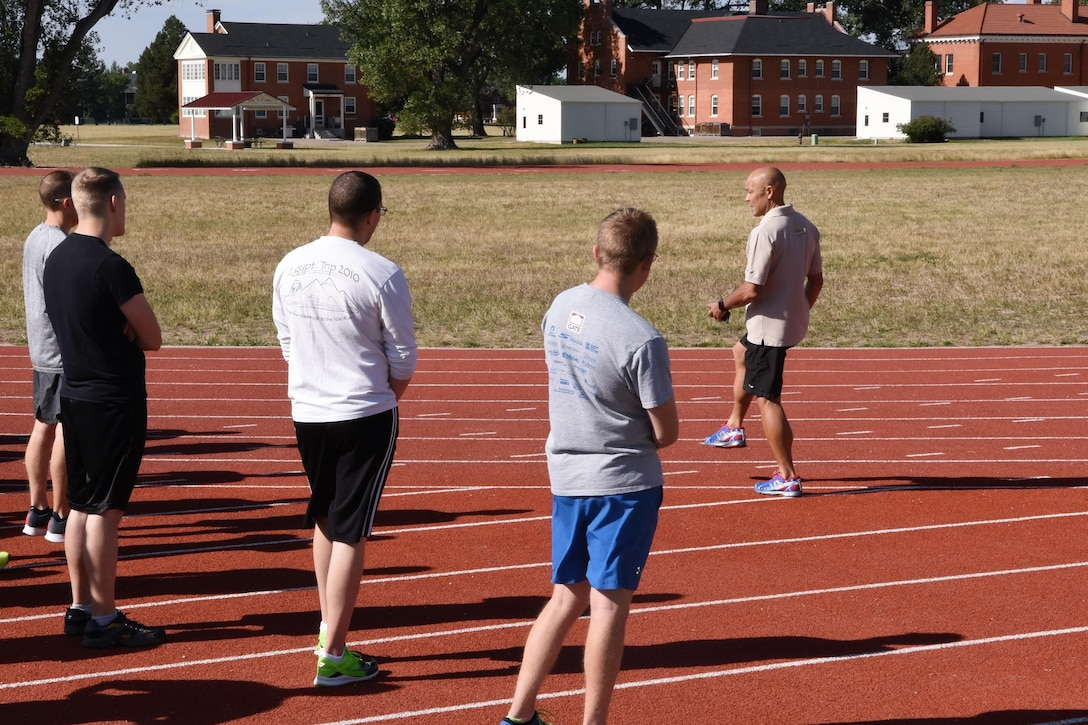 Biomechanical Specialist Ian Adamson and natural running clinic participants practice various drills and running forms to increase the longevity of one's physical health at F.E. Warren Air Force Base, Wyo., Sept. 13, 2017.
