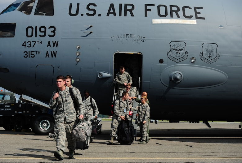 Airmen return to Joint Base Charleston Sept. 15, 2017 with the final C-17 Globemaster III that was evacuated due to Hurricane Irma's potential landfall. Twenty-two C-17s were evacuated to alternate locations and eight were diverted in response to the hurricane. Airmen from the 437th Aircraft Maintenance Squadron ensured the relocated aircraft were maintained and prepared to conduct hurricane recovery operations from alternate installations including Scott Air Force Base, Ill.